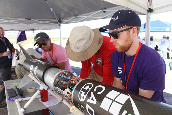 students working on the rocket