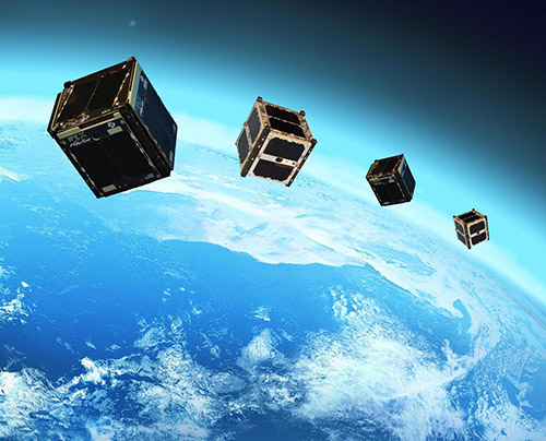 four cubesats orbiting the earth