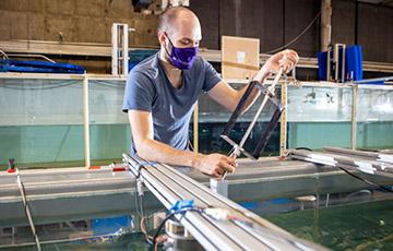 Aidan Hunt inspects a marine energy turbine