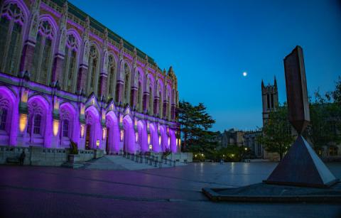 UW building light up in purple